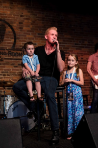 """Devin McGlamery performs """"While I Still Can,"""" with a little help from his children, Preston (L) and Karlyn (R) during the release concert for Love Is A Verb, at The Listening Room Café in Nashville, TN  // Photo: Joshua Clark Photography"""