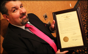 Jonathan Edwards holds a framed proclamation from the State of the Missouri, honoring The Lesters for 89 years of distinguished service in gospel music.