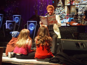 "During his Christmas concert, David Phelps called children from the audience to read his humorous book, ""Santa Claus Get Well Soon."" Photo by John Herndon"