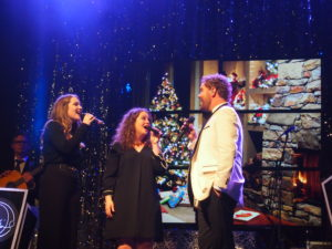David Phelps sings with his daughters, Maggie Beth, left, and Callie during a performance at Shelbyville, Ky. Photo by John Herndon