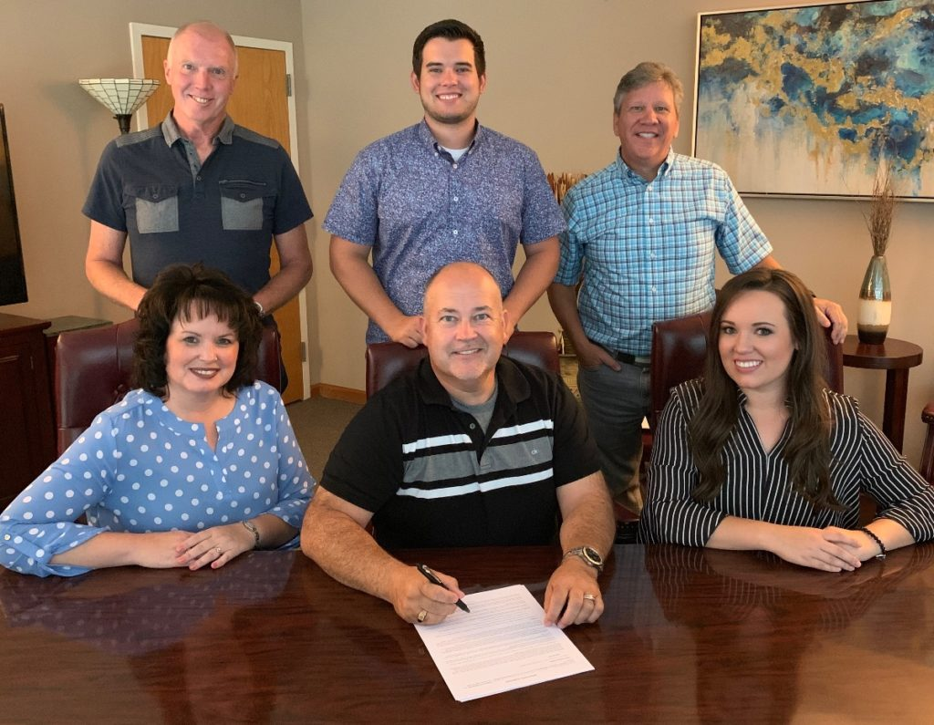 The Lore Family has signed with Horizon Records. Back row, from left, are Crossroads' Roger Talley, The Lore Family's Samuel Lore and Crossroads' Greg Bentley. Front row, from left, are The Lore Family's Sandy Lore, Darren Lore and Fayth Lore. Click on the photo to download.